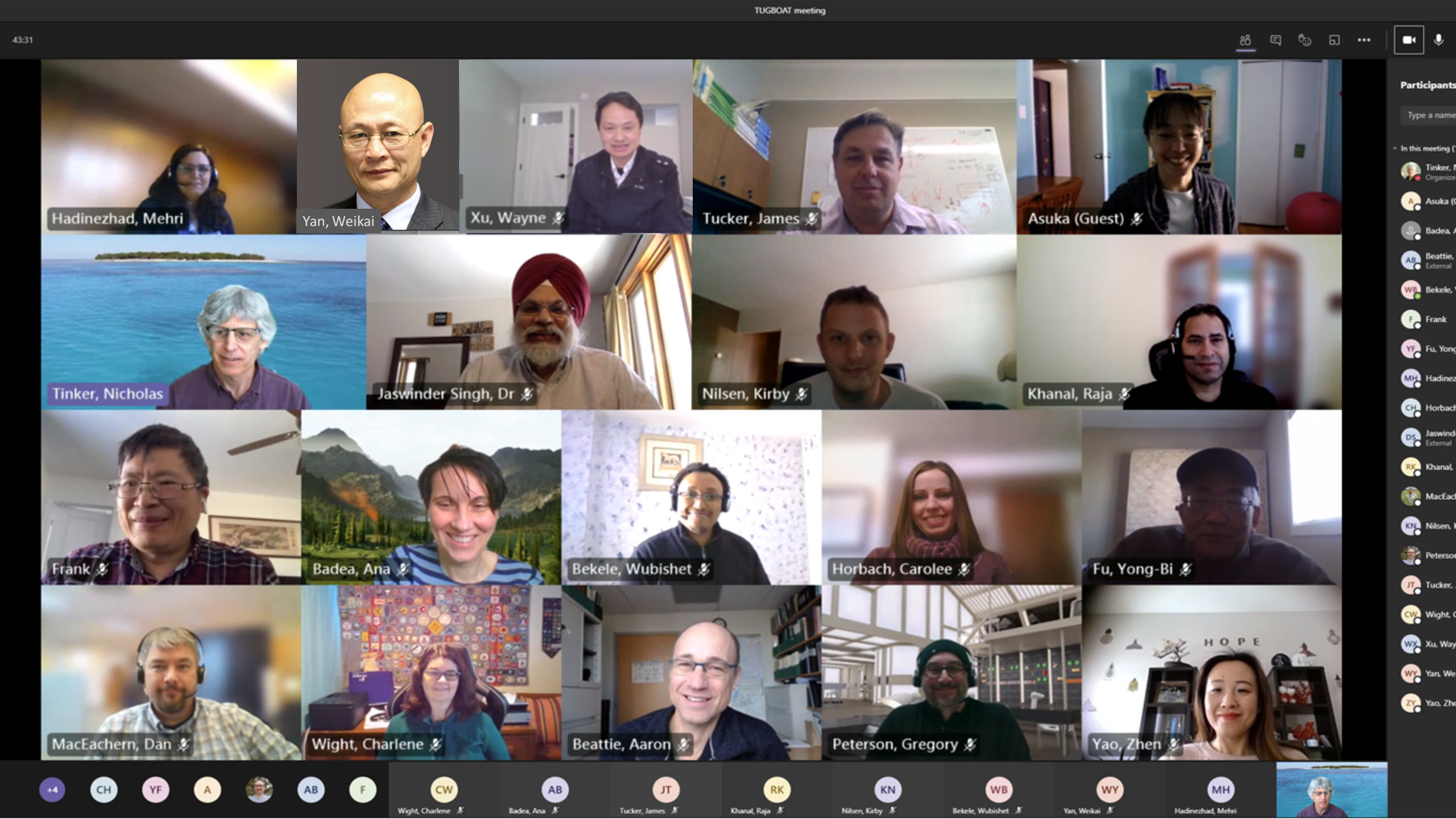 A photo of 19 of the team members in individual boxes as they attend a virtual meeting.